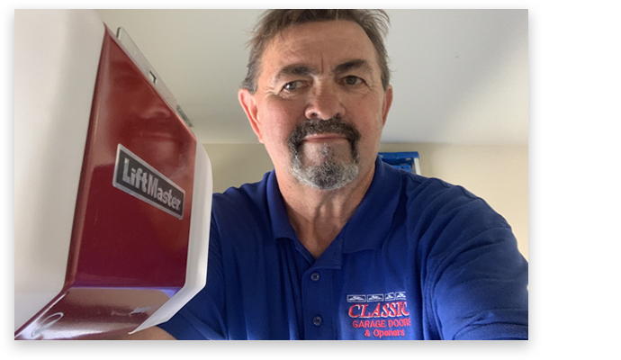 Photo of the owner in blue logo shirt working on a Liftmaster motor